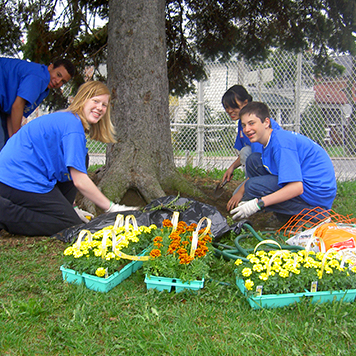 WE Schools students planting flowers