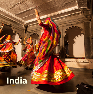Local Indian women in traditional dress dancing