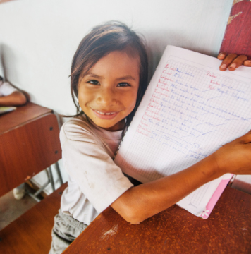 Local student showing her notebook in Ecuador