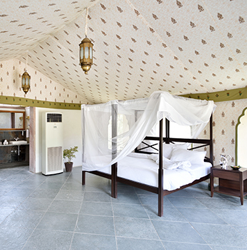 Luxurious and large interior of bedroom at the Araveli Lodge in India