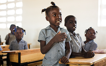 Young local students in a classroom in Haiti