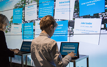 Visitors taking a Live WE pledge at the WE Global Learning Center