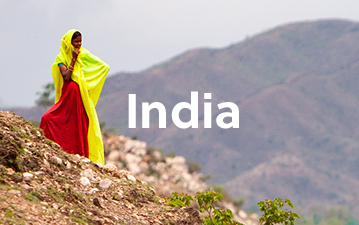 Young local girl overlooking landscape in India