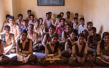 Students in their new classroom in Kalinjar.