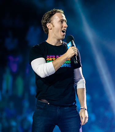 Craig Kielburger speaking at WE Day event