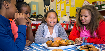 WE Schools students with baked goods for WE Bake for Change