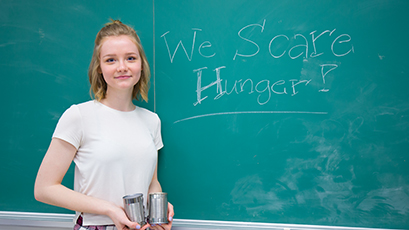 Student collecting food donations for WE Scare Hunger