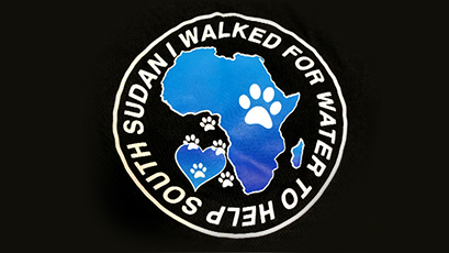 "A closeup of a logo that says ""I walked for water to help South Sudan."""