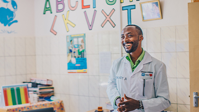 A doctor stands in a classroom