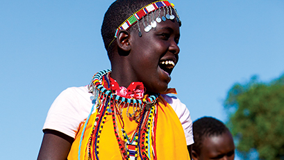 Locals in traditional clothing dancing in Kenya