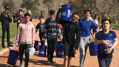 Students walk for water.