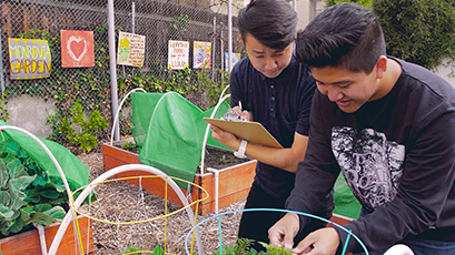 WE Schools students working on an outdoor project
