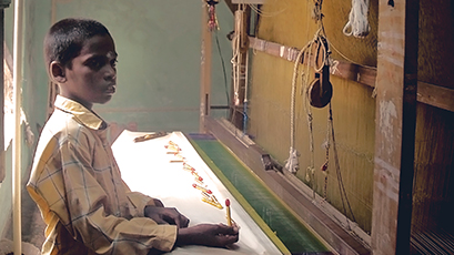 A young boy working in textile production in a developing country