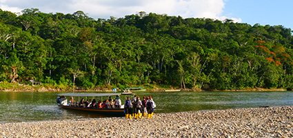 Volunteers arrive at the Minga Lodge via the Napo River on boat