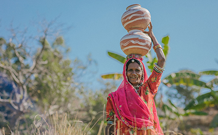 A woman carrying water