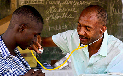 A doctor attending to a patient in Haiti