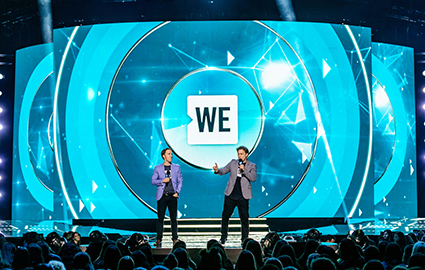 Marc speaking next to brother Craig at WE Day