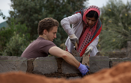 Craig Kielburger and Malala Yousafzai on a build site in Kenya