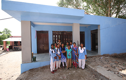 Female students in front of new washroom block in India