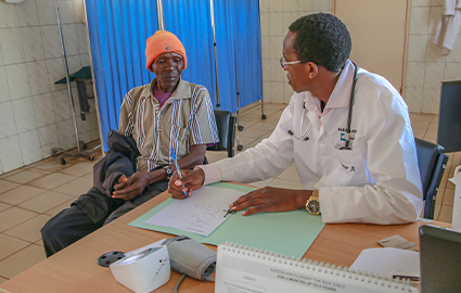 Local doctor treating patient at Baraka Hospital