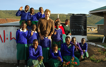 Marc with students in Kenya around a new water well