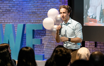 Craig Kielburger speaking to a school group in the WE Global Learning Centre