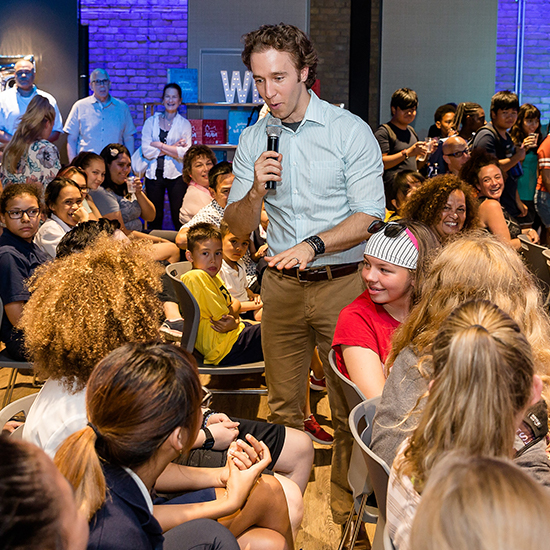 Craig Kielburger speaking to a group of students and teachers