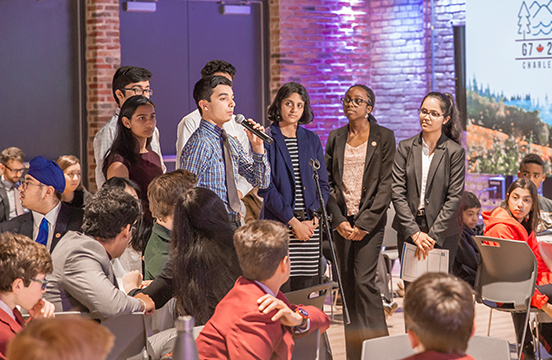 Student speaking at event at WE Global Learning Center