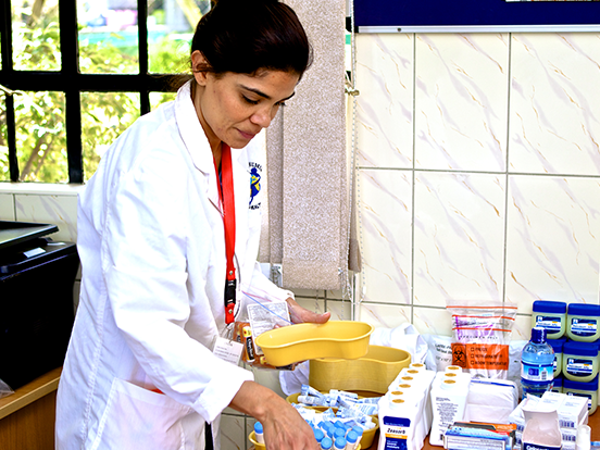 A local health care professional working in a lab