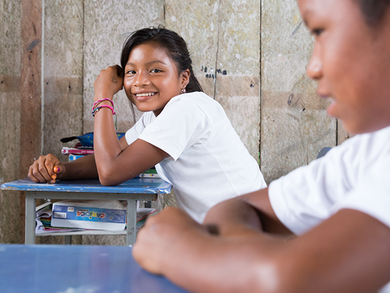 Local students sitting at desks in a classroom in Ecuador