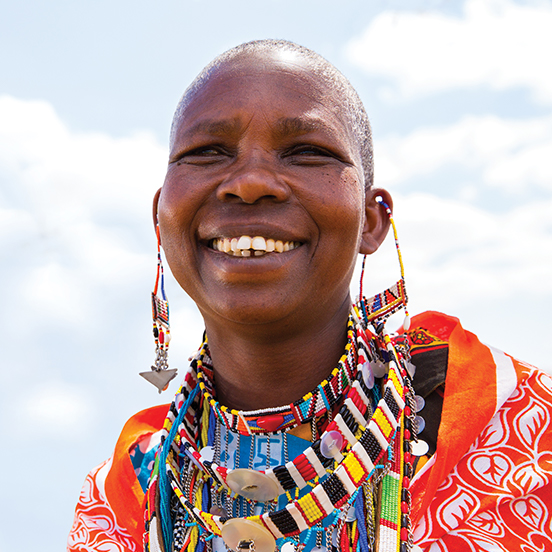 A local Kenyan artisan smiles for her picture