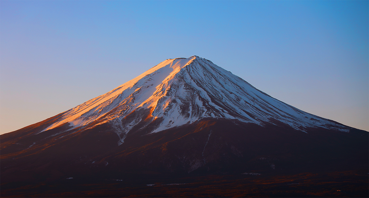 snow capped mount fuji at sunset