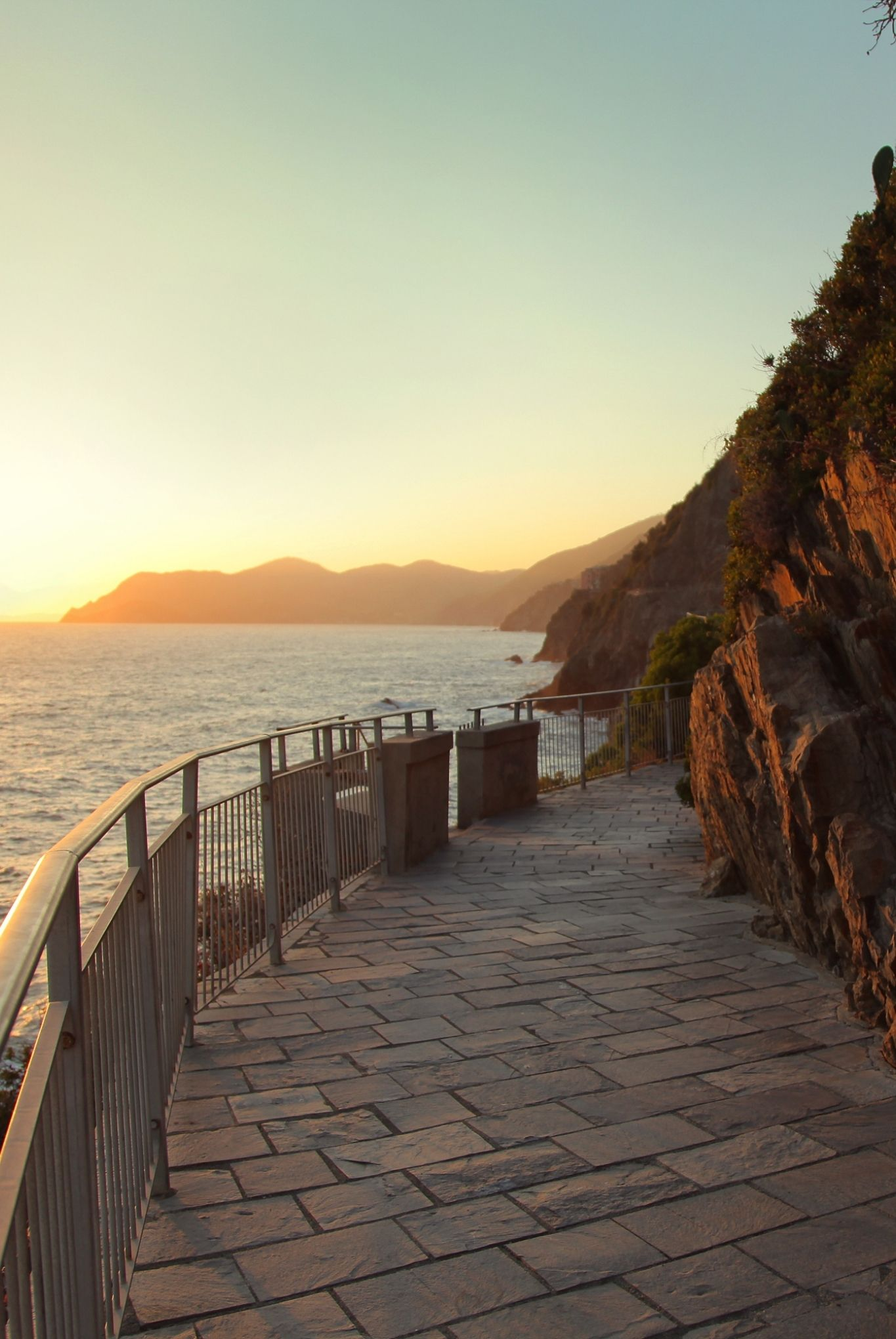 via dell amore path at sunset along coast in cinque terre italy