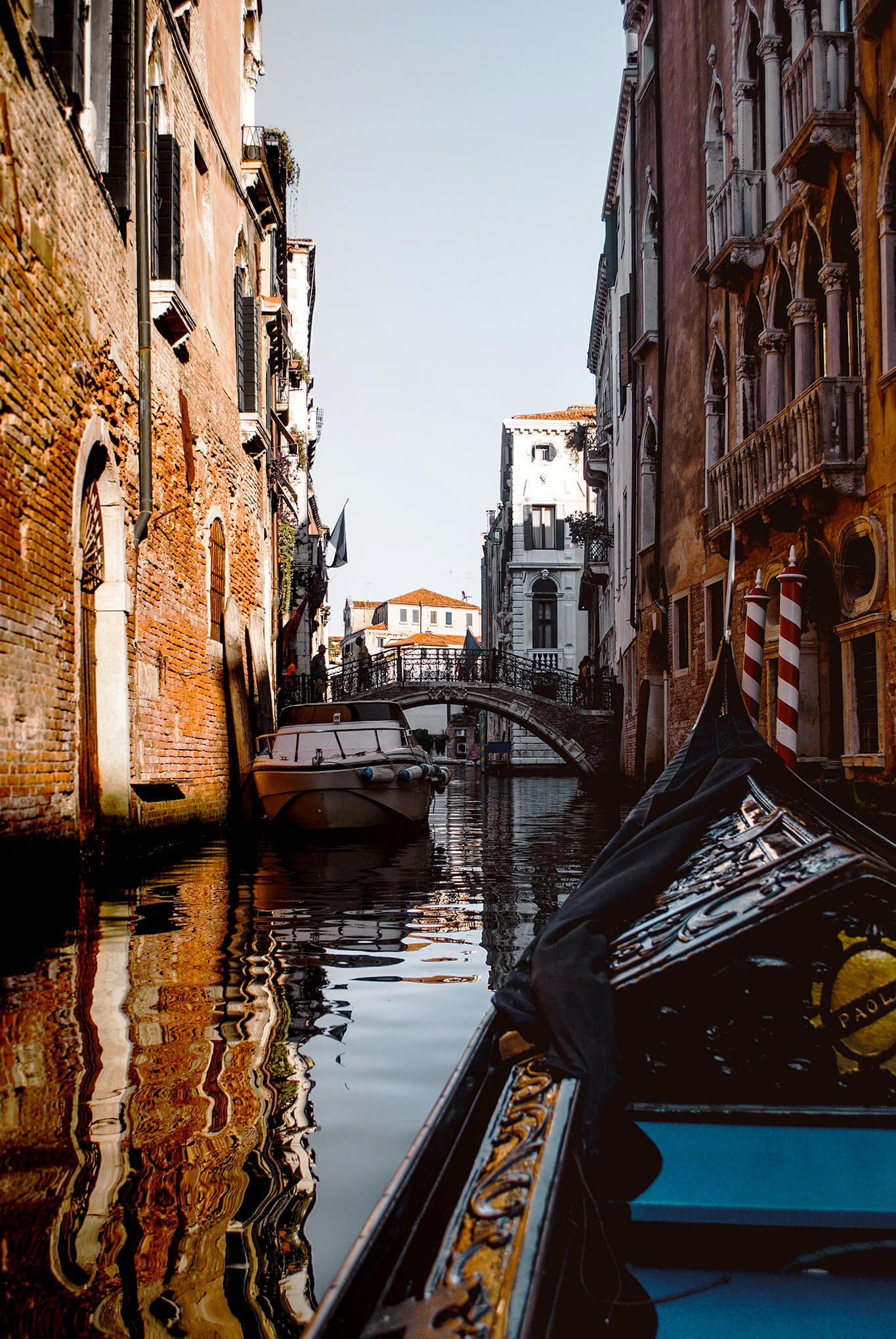 Point of view from riding in gondola through the canals of Venice, Italy
