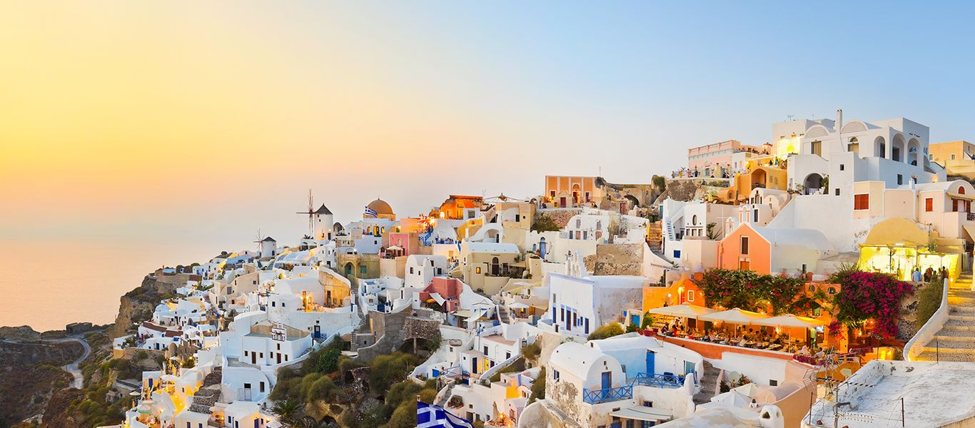 white buildings on the island of santorini at sunset
