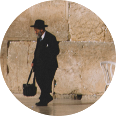 man walking along the western wall