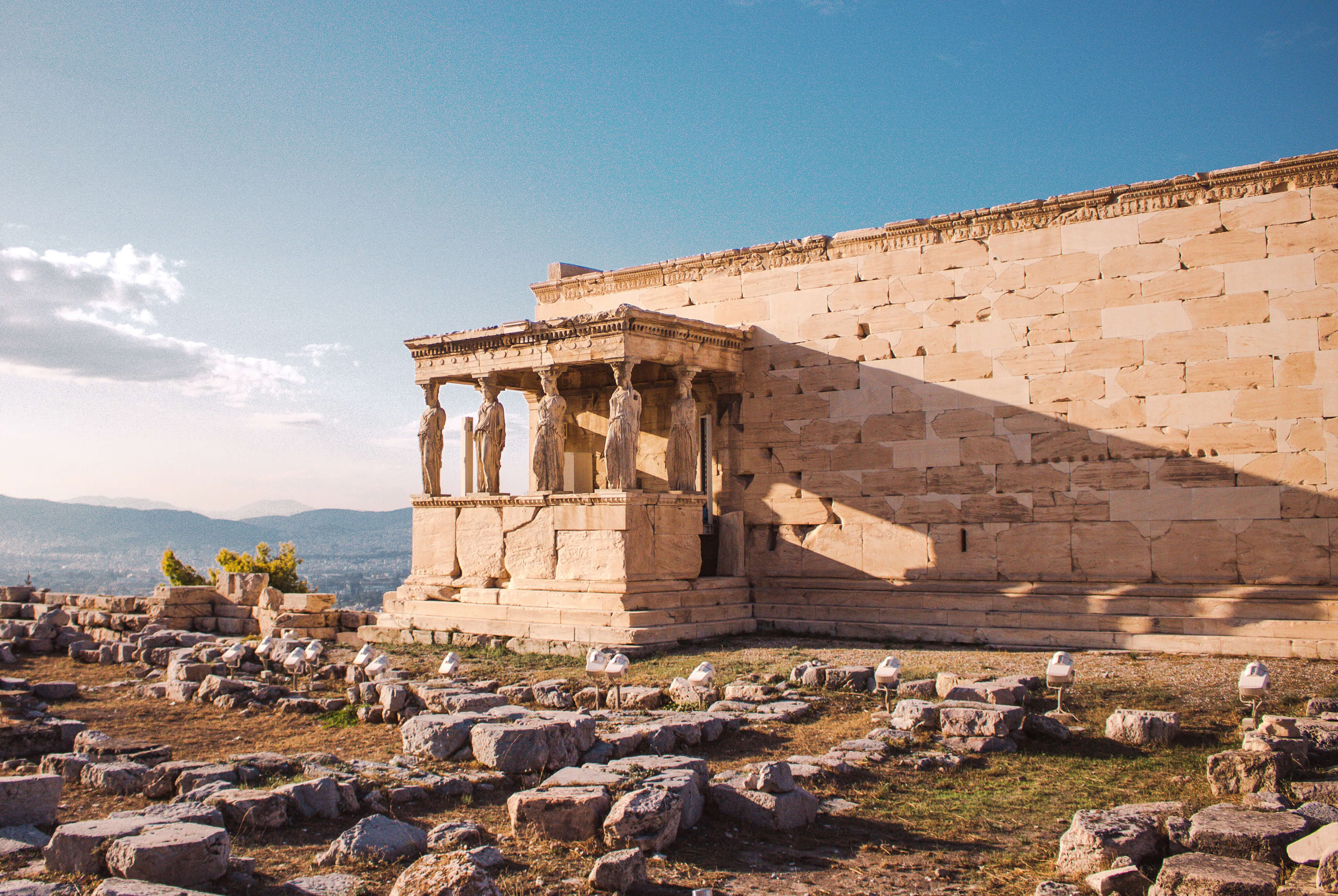 View of the stone Erechtheion at the Acropolis in Athens, Greece, on a sunny day