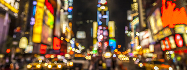 blurred out image of time square at night in new york city