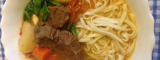 close up of Taiwanese beef stew in a white bowl