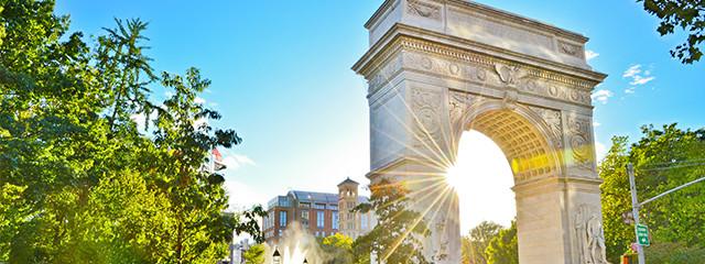 sun beam shining through arch at washington park in new york city