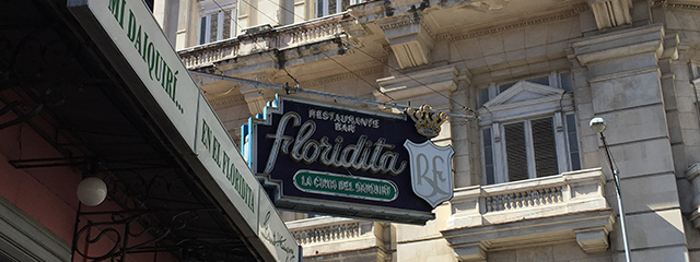 metal sign hanging from a cafe building in cuba saying el florida