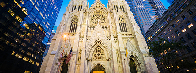 saint patricks cathedral lit up at night in new york city