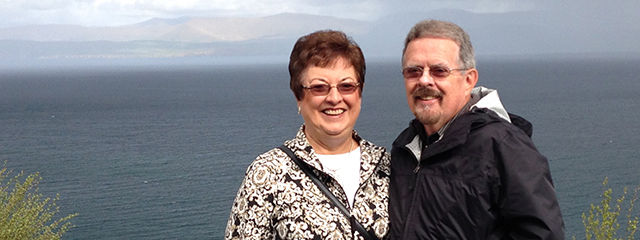 travelers jerry and frances standing on cliffs of moher in ireland