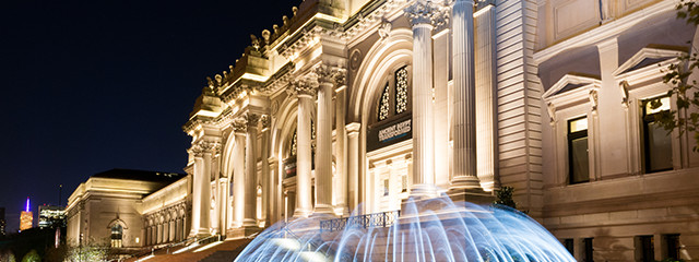 fountain outside the met in new york city at night