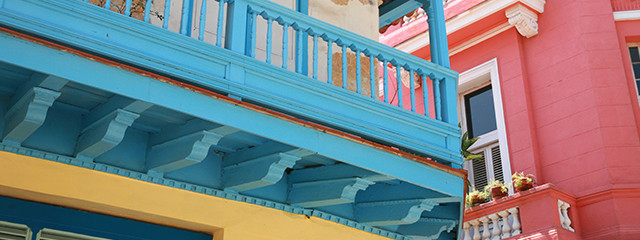 close up of blue and pink buildings in havana cuba