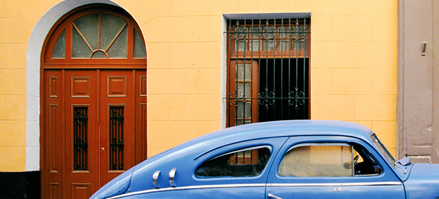 top of a bright blue car on the street in cuba