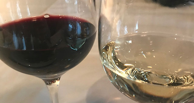 glass of white and red wine next to each other