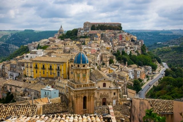 buildings on top of hill in sicily italy