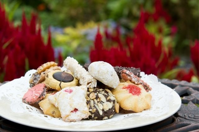 italian cookies on a white plate outside on a table