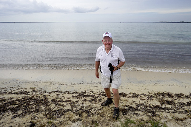 traveler stephen holding a camera at the bay of pigs in cuba